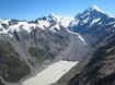 This photo of Mount Cook (top right) and the Hooker Valley shows numerous glacial features such as sharp rock and ice ridges (aretês), snowfields, ice cliffs, a U shaped valley, moraine covered glacier, truncated spurs, lateral moraine platforms and a terminal lake. Image: Julian Thomson.