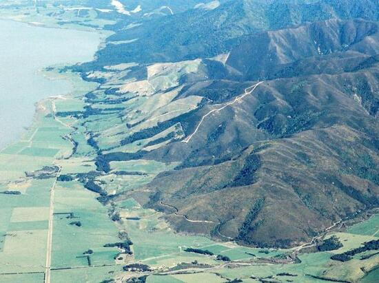 Looking south along the Wairarapa fault (left of centre), the uplift is on the right (west). Image: GNS Science.