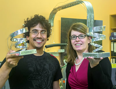 Jerome Leveneur and Karyne Rogers with the trophies they received for winning their categories in the 2016 Technology Valley Awards. Photo - Margaret Low.