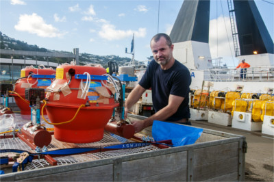 GNS Science technician Randall McDonnell prepares to load ocean bottom seismometers onto the Tangaroa before setting off for Poverty Bay where they will be deployed on the seafloor. Photo - Margaret Low, GNS Science