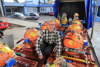 Voyage co-leader Dr Stuart Henrys of GNS Science with some of the 32 deep-sea seismic instruments that will be placed on the seafloor off Poverty Bay during the next 10 days. Photo - John Callan, GNS Science