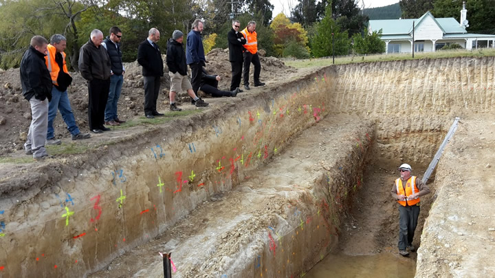 Geologist David Barrell hosts a group of council staff at one of the fault trenches south of Dunedin. GNS Science also hosted school groups, local body politicians, community groups, and the media to the fault trench site. Photo - Rob Smillie, GNS Science.