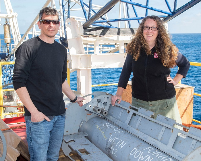 Expedition co-leaders Dr Demian Saffer of Pennsylvania State University and Dr Laura Wallace of GNS Science with one of the observatory wellheads before it was installed in the Hikurangi subduction zone east of Gisborne.