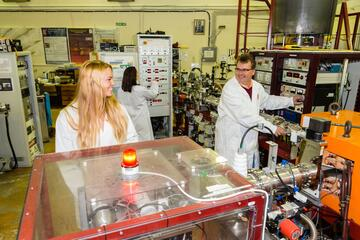 PhD student Zoe Voisard and principal scientist Andreas Markwitz in the ion beam and nanotechnology laboratory at GNS Science, where conference delegates will have a guided tour on Tuesday. Photo - Margaret Low, GNS Science