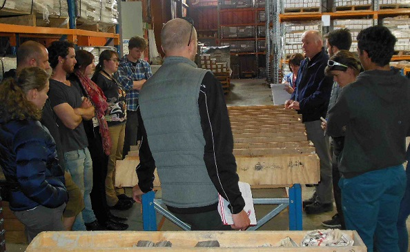 Greg Browne shows graduate students cores at the CoreLab facility in New Plymouth