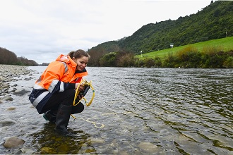 taking water sample from the Hutt River for radon measurement