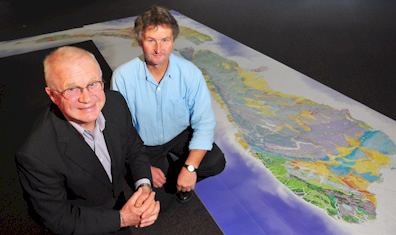 GNS Science Chief Executive Alex Malahoff and QMap Project Leader Mark Rattenbury with a 6m-long compilation version of the new national geological map of New Zealand. Photo: Margaret Low, GNS Science