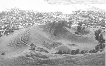 Figure 6: Mount Mangere. The view is northward into the crater of the scoria cone. The cone has been breached on the eastern side by a lava flow. At the end of the eruption a small lava dome built up in the crater.