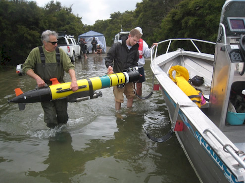 Scientists load an autonomous underwater vehicle (AUV) onto a support boat during the underwater survey of Lake Rotomahana in January 2011. Photo:Julian Thomson, GNS Science