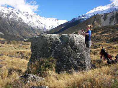 A large boulder on the Birch Hill moraines being sampled for beryllium-10 dating by Alice Doughty, an author of this study and currently undertaking PhD research at Victoria University of Wellington. Photo: Aaron Putnam.