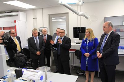 Senior scientist Bruce Mountain gives the official party a guided tour of the revamped facility at GNS Science's Wairakei campus