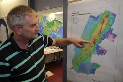 Marine geologist Dr Cornel de Ronde points out features on the new bathymetric map of the Colville Ridge.
