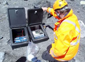 GNS Science technician Jeremy Cole-Baker checks electronic measuring equipment at the edge of Ruapehu's Crater Lake. Photo: GNS Science