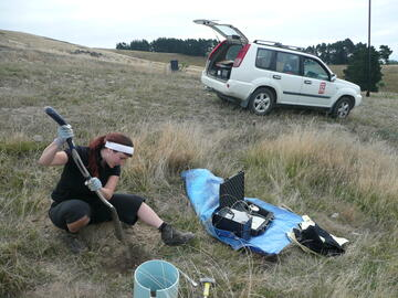 Deploying a portable seismometer above Sumner, Christchurch