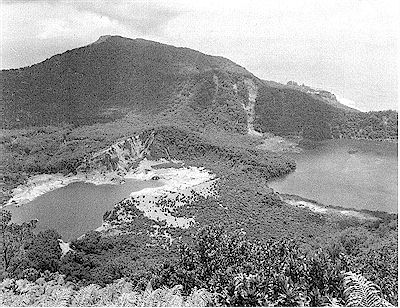 Raoul Island – looking north-west across Raoul Caldera from Moumoukai Peak, with Blue Lake on the right, and Green Lake on the left, and the Weather Station on Fleetwood Bluff in the right background. Photograph by B.D. Scott