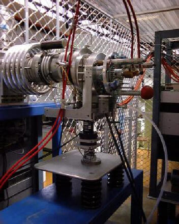 A nuclear particle accelerator consists essentially of two linear accelerators joined end-to-end, with the join section (called the terminal) charged to a very high positive potential (3 million volts or higher).