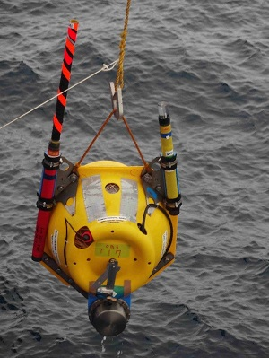 OBS instrument being dropped in the sea