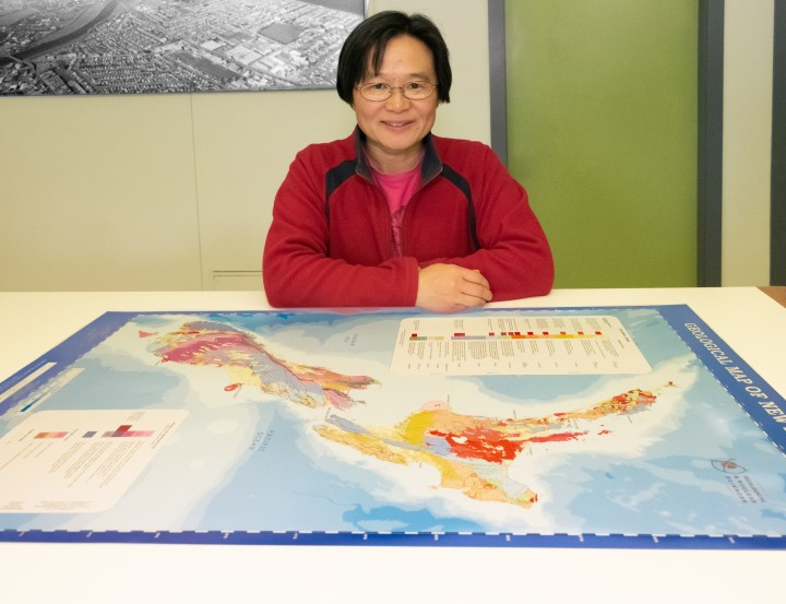 Geologist Julie Lee with the updated QMAP. Photo: Margaret Low