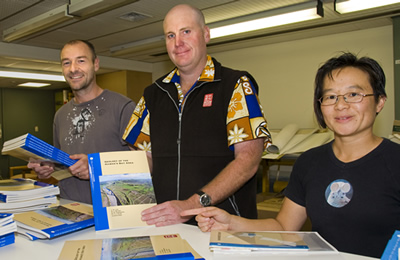 Geologists Dougal Townsend, Kyle Bland, and Julie Lee with the recently published geological map of Hawke's Bay.  The map is the final in a series of 21 digital maps covering the whole of New Zealand. Photo: Margaret Low, GNS Science