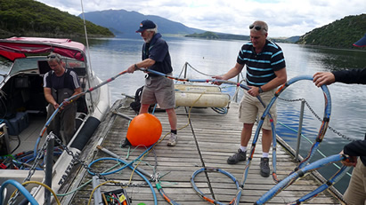 Scientists prepare the seismic reflection gear before heading out to survey the lake floor of Lake Rotomahana, southeast of Rotorua. Photo: Julian Thomson