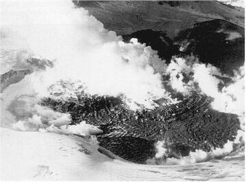 Figure 2: Aerial view of Ruapehu crater on 17 July 1945 showing lava dome that grew over a period of 4 months displacing all the water from Crater Lake. (RNZAF Collection)