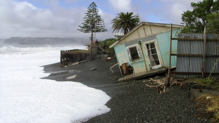 Small house about to be engulfed by sea. Photo: Alan Blacklock