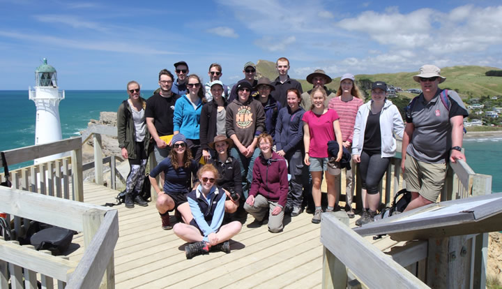 Students on the masterclass explore Castlepoint on the Wairarapa coast with GNS Science geologist Dr Kyle Bland.