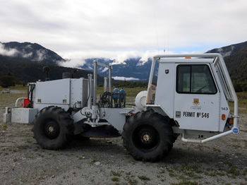 This special 'vibrating' truck is among the tonnes of equipment that has been brought to Whataroa from Canada, Germany and the United Kingdom to build a two-dimensional underground image of the Alpine Fault.