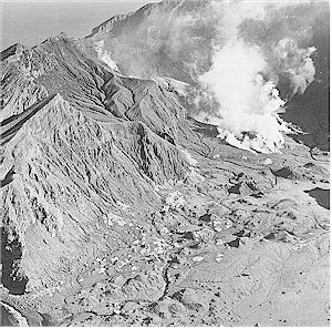 Figure 3: Mounds left by the 1914 avalanche cover the main crater floor. Steam clouds rise from the Donald Mound fumaroles, obscuring 1978 Crater behind - Photo by D L Homer.