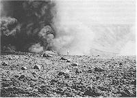 Figure 4Ash eruption at White Island on 4 April 1977. Lava bombs and blocks cover the main crater floor in foreground. Note geologist on crater rim for scale - Photo by S Nathan