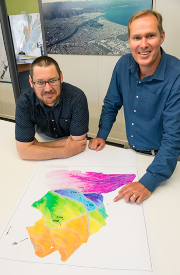 Geologists Will Ries (left) and Robert Langridge of GNS Science with a digital terrain elevation model of the section of the Alpine Fault where  they are planning to investigate the fault's rupture history. Photo - Margaret Low, GNS Science